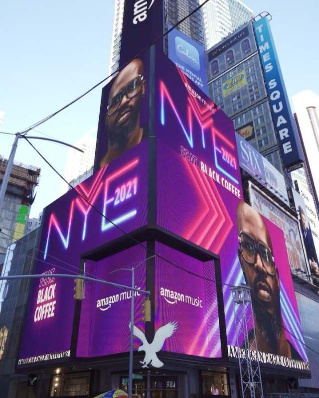 DJ Black Coffee pictured on a Times Square billboard in New York City